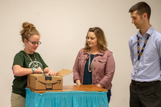 Carencro High senior Ariel Green opens a box from Amazon to find out she will receive a $40,000 college scholarship and a 12-week summer internship with Amazon. Her teachers, Claire Trouard and Daniel Soileau, are surprising her with the news.
