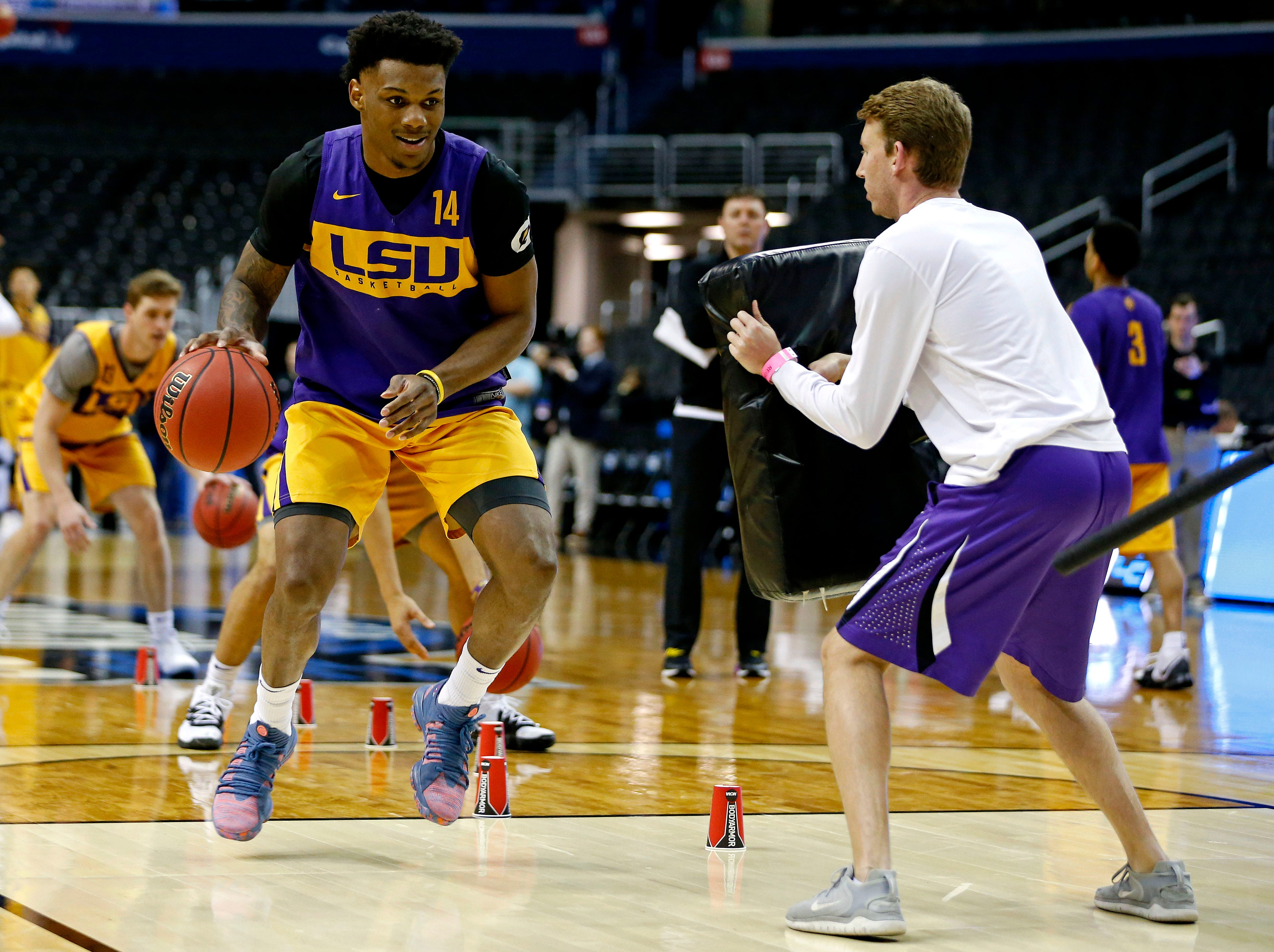 Mar 28, 2019; Washington, DC, USA; LSU Tigers guard Marlon Taylor (14) handles the ball during practice for the east regional of the 2019 NCAA Tournament at Capital One Arena. Mandatory Credit: Amber Searls-USA TODAY Sports
