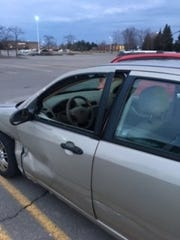 A man was slumped over in this car Sunday, March, 24, 2019. Michigan State Police Trooper Michael Thomas made was able to open the door and get the man out.
