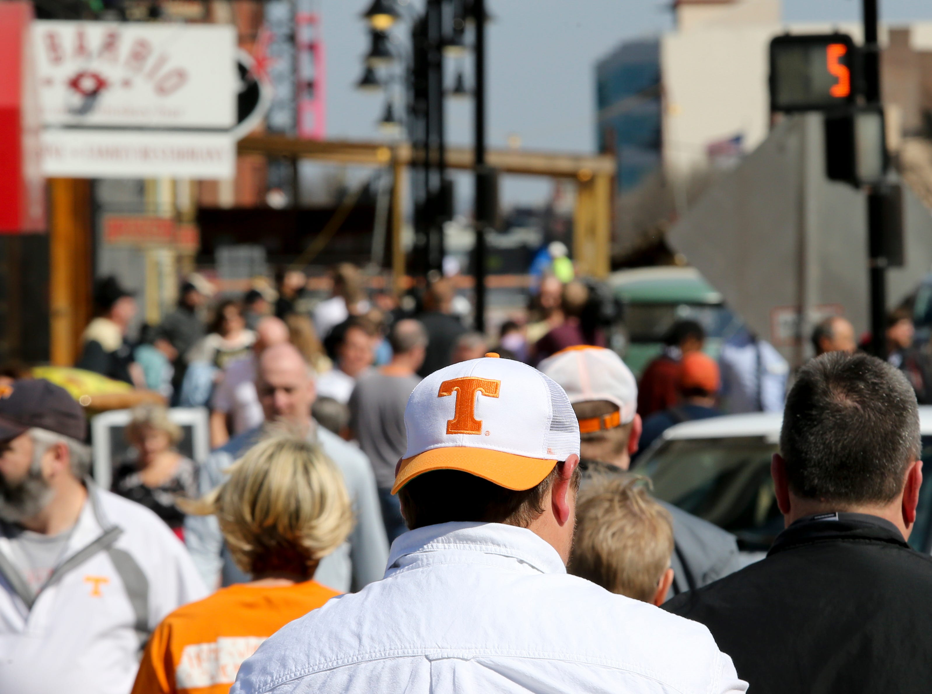 Tennessee, Purdue, Virginia and Oregon fans walk around downtown Louisville on March 28. They are in town to watch their teams play in the NCAA Sweet 16.