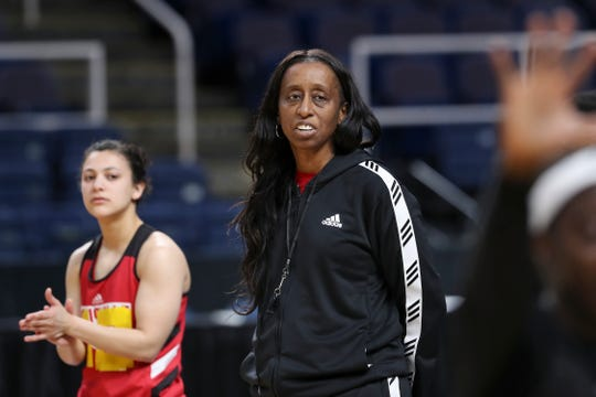 U of L assistant coach Samantha Williams watched the team practice ahead of their matchup with Oregon State at the Sweet 16 in Albany, N.Y.  Williams has just been named the new head coach at Eastern Kentucky University. March 28, 2019