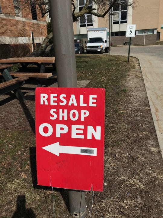 A sign directs customers Wednesday, March 27, 2019, to the Thrifty Sparrow Resale Shop. The shop, in the basement of the former St. Lawrence Hospital, is closing Friday when remaining items will be offered free.