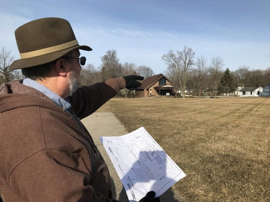 Phil Grimwood, director of Helping Hands Food Pantry in Charlotte, talks about plans for a new facility on the edge of a 1-acre parcel of land off Jefferson Street where the nonprofit will break ground on the building in April.