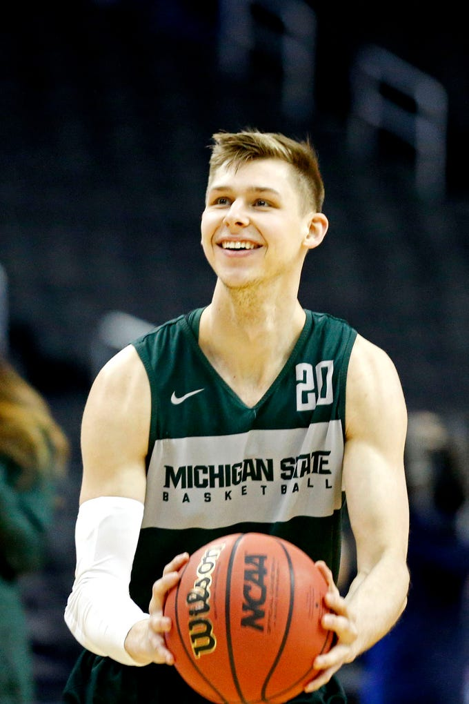 Mar 28, 2019; Washington, DC, USA; Michigan State Spartans guard Matt McQuaid (20) shoots the ball during practice for the east regional of the 2019 NCAA Tournament at Capital One Arena. Mandatory Credit: Amber Searls-USA TODAY Sports