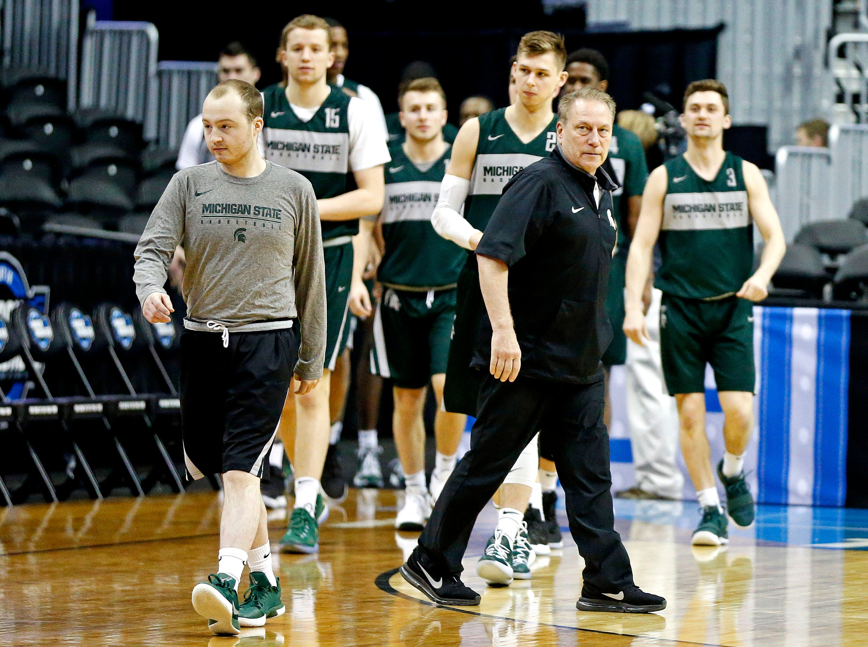 Mar 28, 2019; Washington, DC, USA; Michigan State Spartans head coach Tom Izzo leads his team onto the court during practice for the east regional of the 2019 NCAA Tournament at Capital One Arena. Mandatory Credit: Amber Searls-USA TODAY Sports