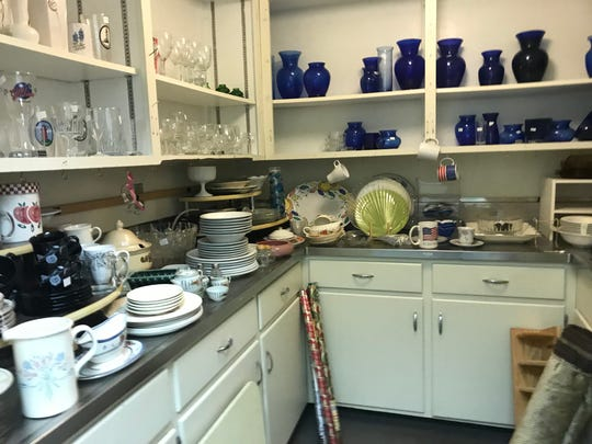 Glassware and dishes sold at the Thrifty Sparrow Resale Shop Wednesday, March 27, 2019. The shop is closing Friday when remaining items will be offered free.