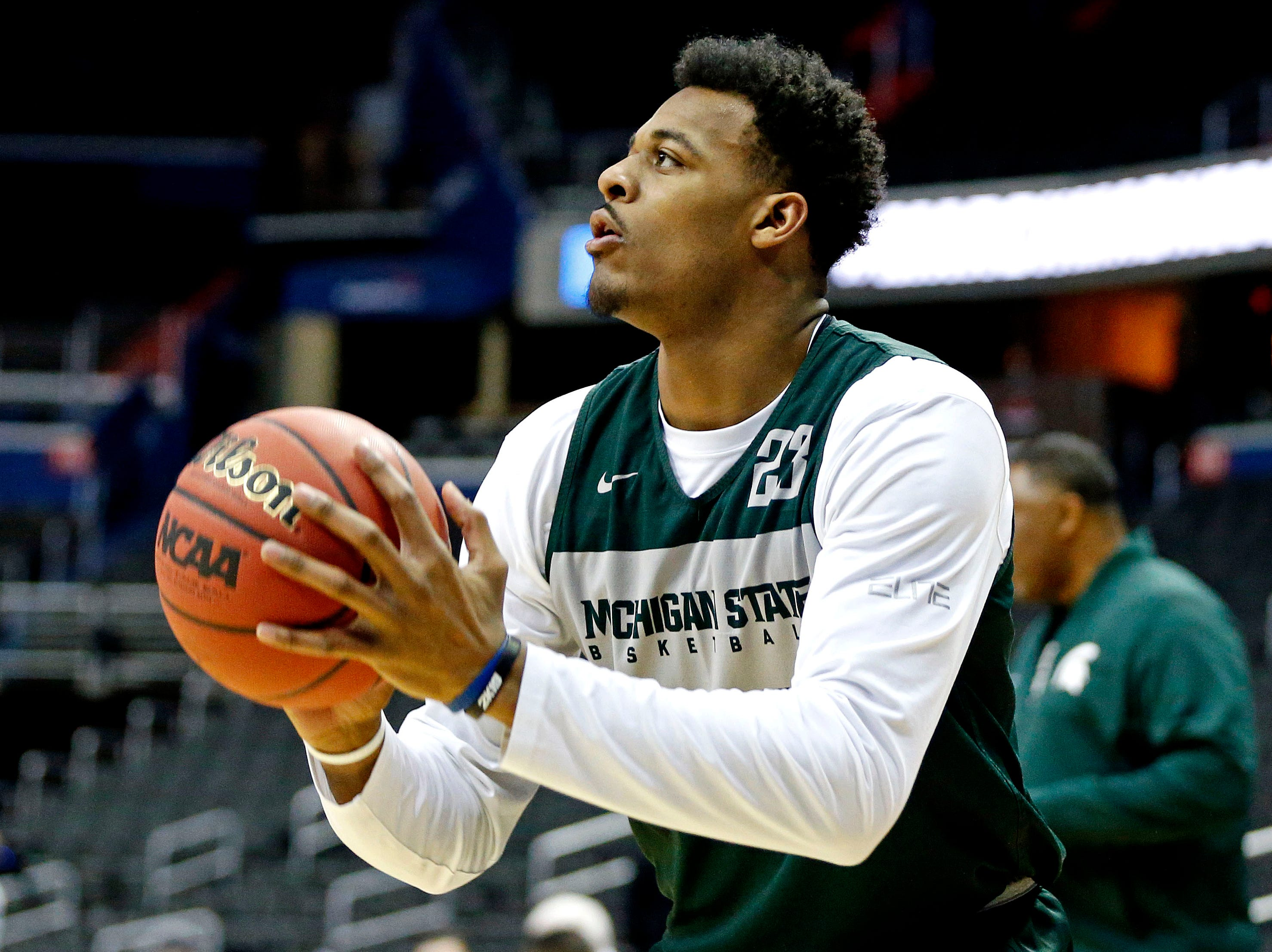 Mar 28, 2019; Washington, DC, USA; Michigan State Spartans forward Xavier Tillman (23) shoots the ball during practice for the east regional of the 2019 NCAA Tournament at Capital One Arena. Mandatory Credit: Amber Searls-USA TODAY Sports