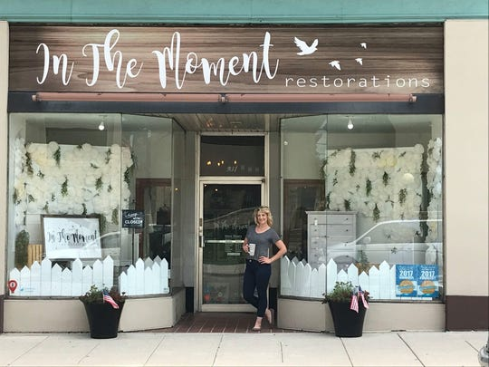 Owner Jennifer Kalista outside her downtown Manitowoc shop In the Moment Restorations.