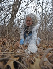 """Theresa Sutter from Richland Soil and Water does her part cleaning up Thursday morning during the """"Great American Cleanup."""""""