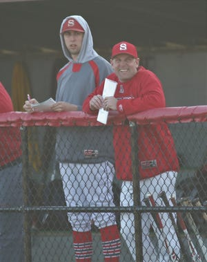 Shelby's Hunter Hoffman (left) and head coach Jon Amicone (right) go over pitching strategy during a game earlier this season. Hoffman was lost to a torn ACL suffered during basketball season and is a NAIA Division II college baseball commit at Indiana Wesleyan.