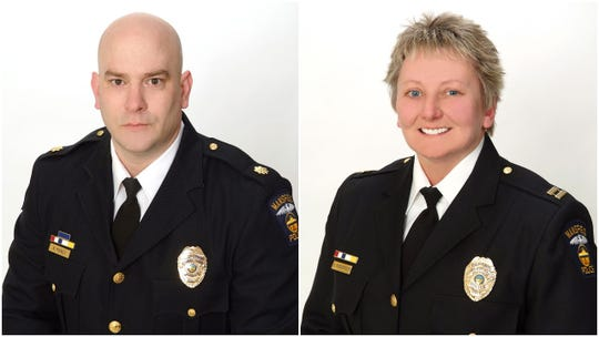 Mansfield assistant police Chief Keith Porch (left) and Capt. Shari Roberson