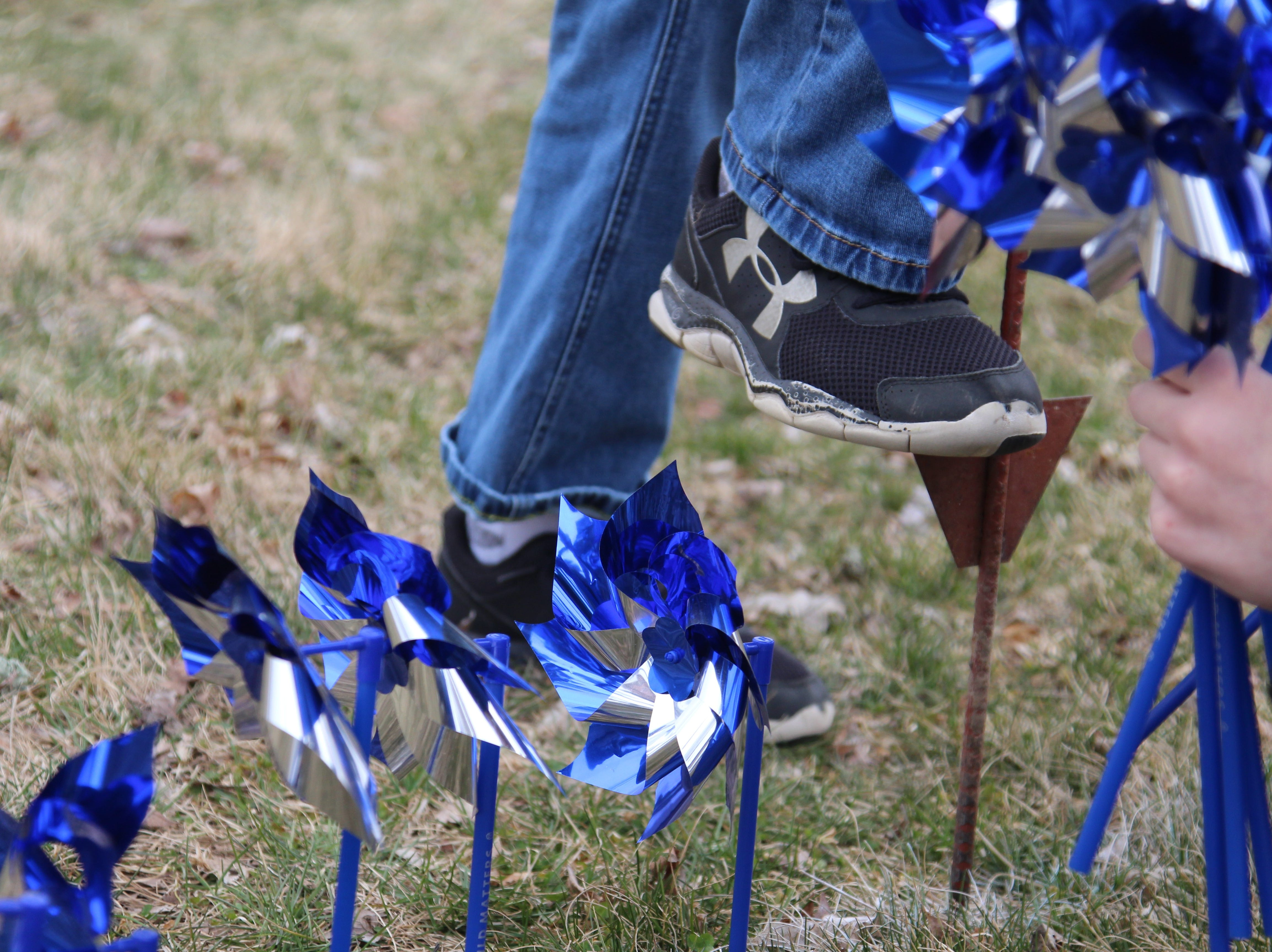 Volunteers planted over 900 pinwheels in front of Marion County Children Services last year with each representing a report of neglect or abuse in the area.  Bryant Brown, the community education coordinator for the agency, said the number of pinwheels planted each year continues to increase.