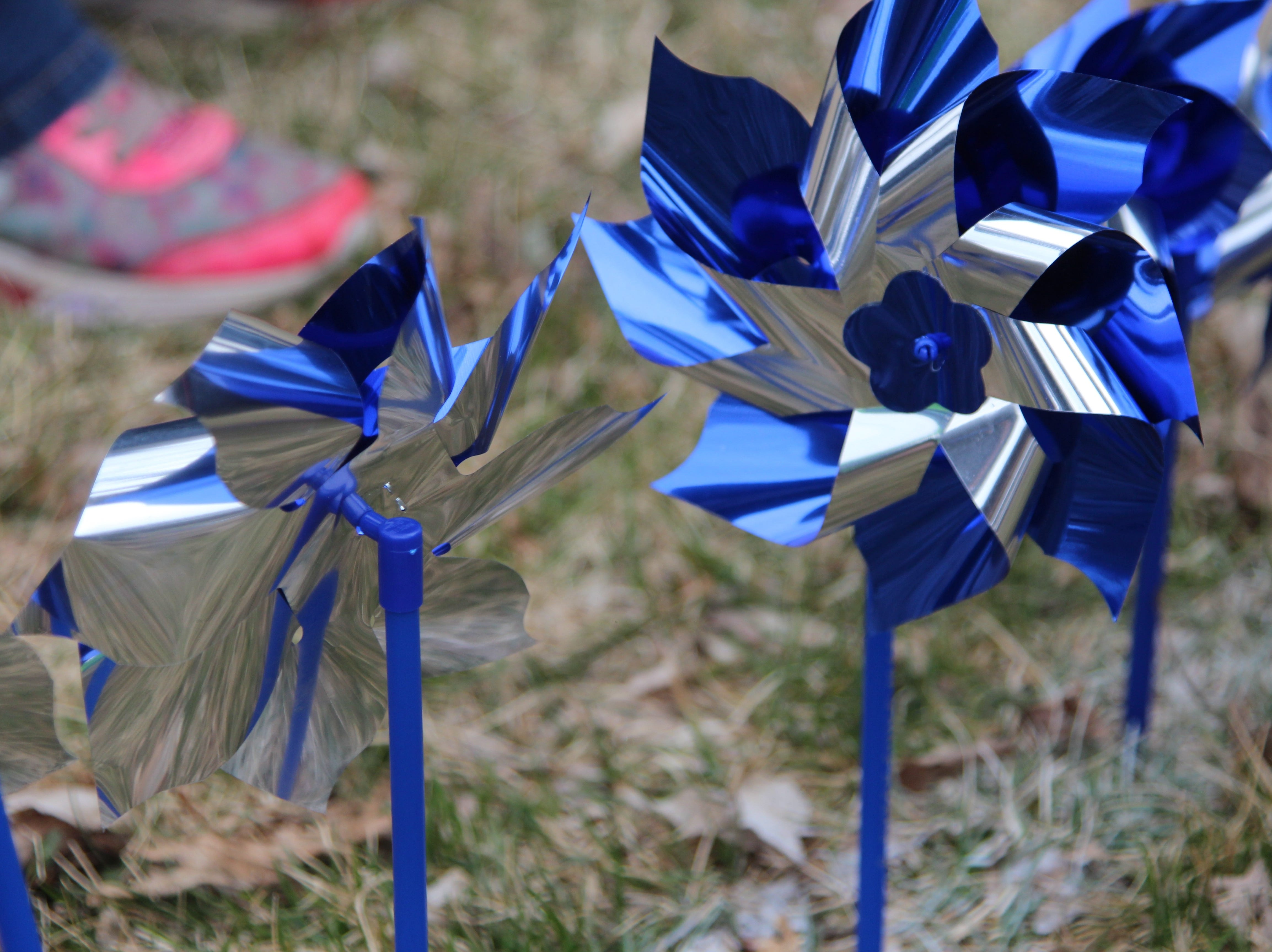 The pinwheel is meant to represent a case of neglect or abuse handled in the county last year. Volunteers and members of Marion County Children Services planted them Thursday afternoon as part of Child Abuse Awareness Month that starts in April.