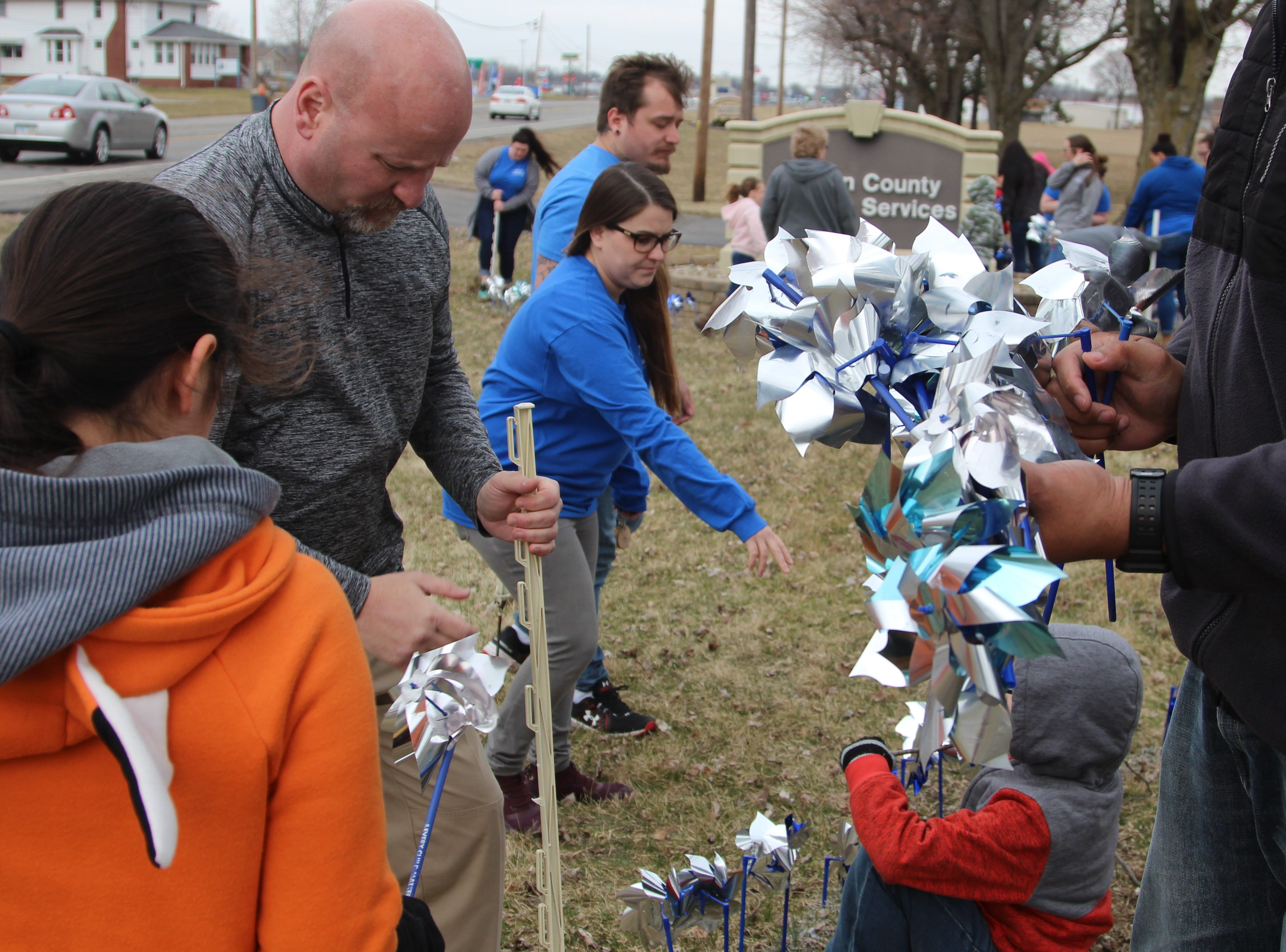 Volunteers and members of Marion County Children Services planted them Thursday afternoon as part of Child Abuse Awareness Month that starts in April.