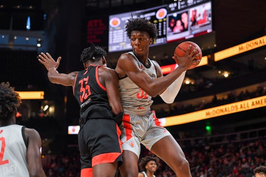 West Team's James Wiseman (32) grabs a rebound during the McDonald's All-American Game in Atlanta on March 27, 2019.