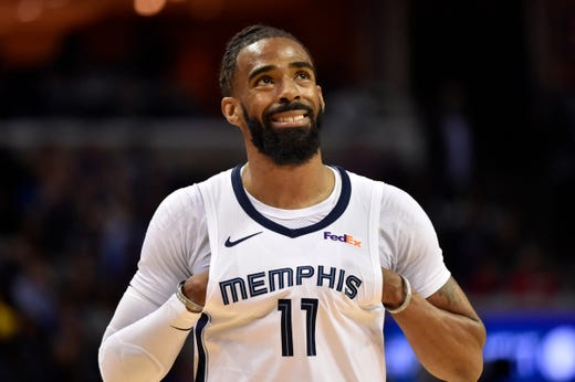 Memphis Grizzlies guard Mike Conley (11) stands on the court in the first half an NBA basketball game against the Golden State Warriors Wednesday, March 27, 2019, in Memphis, Tenn. Conley passed Marc Gasol as the franchise's all-time scorer during the game. (AP Photo/Brandon Dill)