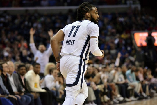 Grizzlies guard Mike Conley (11) plays in the first half Wednesday.