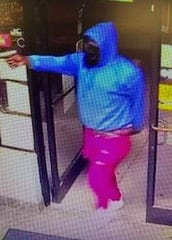 MPD released photos of a man caught on camera conducting an armed robbery at a story on Stage Road Thursday night. The man fatally shot the store clerk.