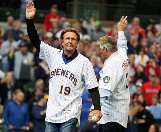 Robin Yount (left) and Rollie Fingers wave to fans before the ceremonial first pitch at opening day as the Milwaukee Brewers take on the. St. Louis Cardinals at Miller Park on Thursday.