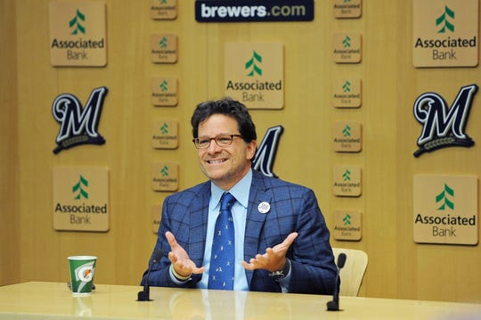 Milwaukee Brewers principal owner Mark Attanasio speaks to reporters before the game against the St. Louis Cardinals at Miller Park on Thursday.
