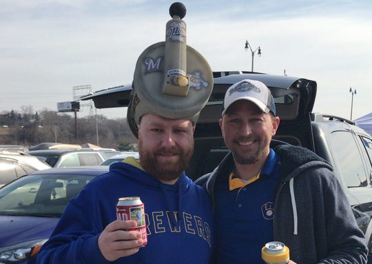 Jason Donahue (left) was tailgating with his friend Reid Fauska. Donahue had a beer barrel hat custom made. The barrel has Brewers logos from throughout the years on it, along with his last name posted across the front.