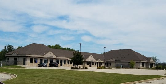 Ozaukee Christian School is purchasing this commercial property on Highway 33 near West Bend that formerly was the site of a strip bar named Spearmint Rhino Gentlemen's Club.