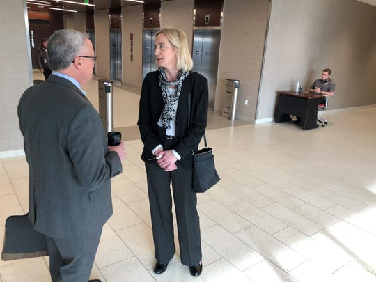 Public Service Commission Commissioner Ellen Nowak, right, and Nowak's adviser Bob Seitz are blocked from returning to work at the PSC on Thursday.