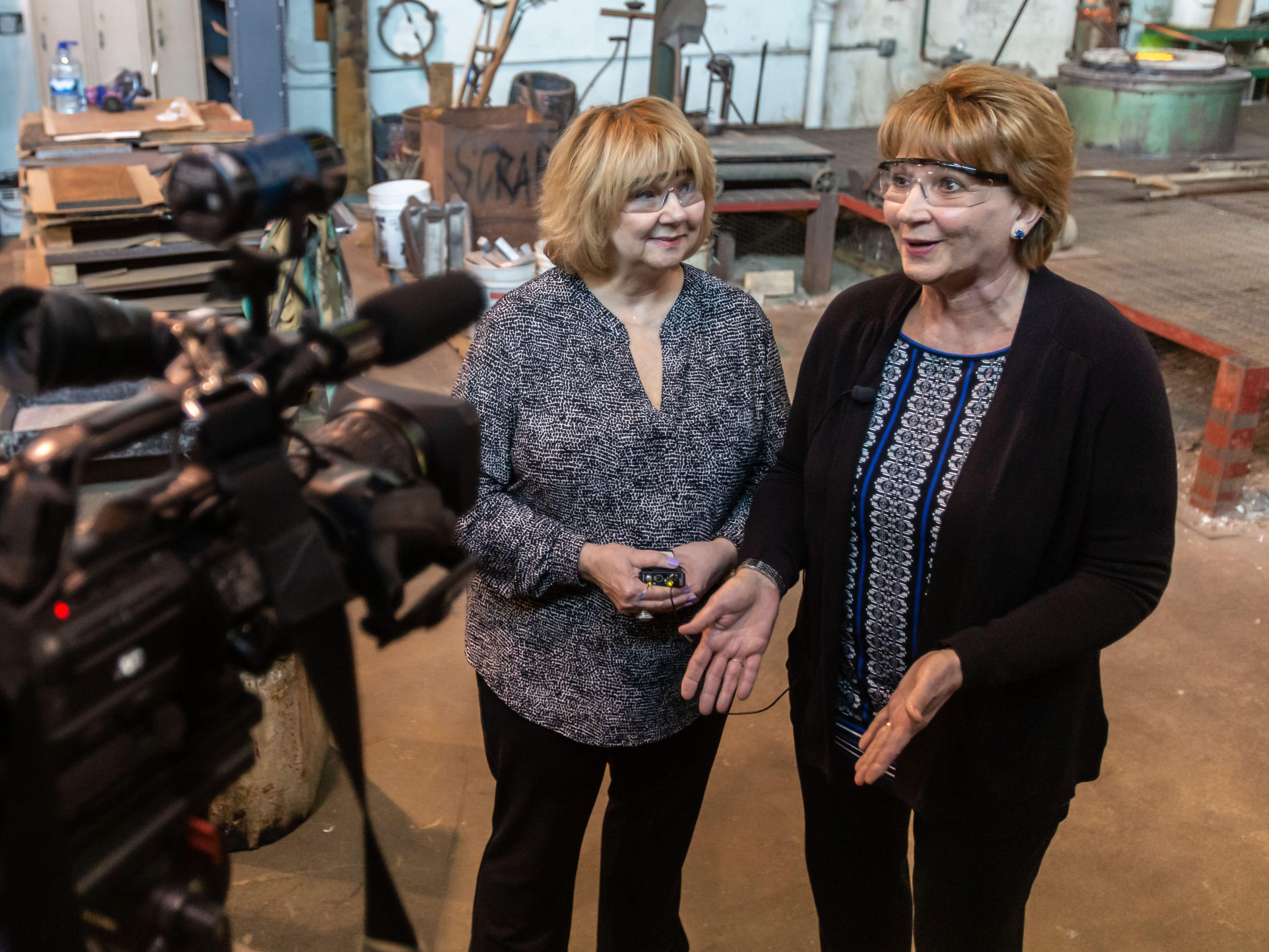 """Daughters of """"Da Crusher"""", Dawn Lisowski (left) and Sherri Brozoski, speak with media prior to the pouring of their father's bronze statue at Vanguard Sculpture Services in Milwaukee on Wednesday, March 27, 2019."""