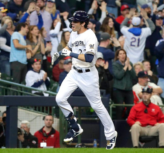 Milwaukee Brewers rightfielder Christian Yelich celebrates after hitting a three-run home run against the Cardinals on Thursday.
