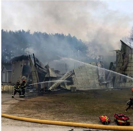 Firefighters tackle a fire at Ethan Allen School in the town of Delafield.