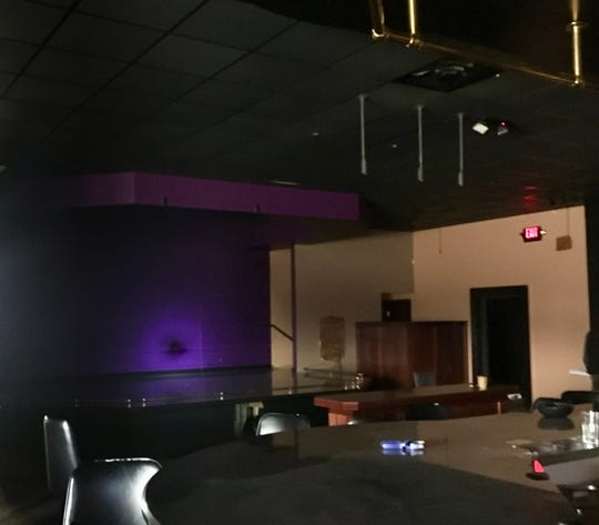 The stage used at the former Spearmint Rhino Gentlemen's Club near West Bend will be removed to make room for the building's surprising new owner, Ozaukee Christian School.