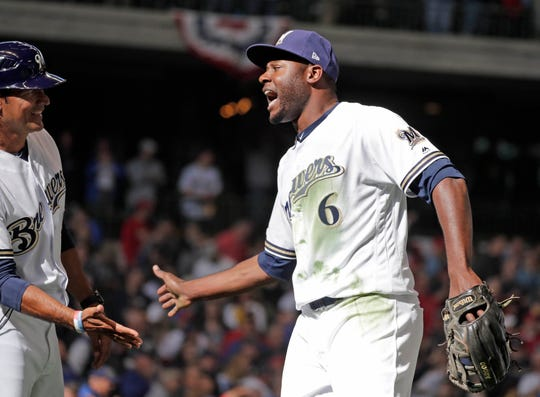 Milwaukee Brewers center fielder Lorenzo Cain (6)  is congratulated by team mates after he makes a leaping catch for the final out in the 9th inning as the  Milwaukee Brewers beat the St. Louis Cardinals 5-4 in the MLB game at Miller Park in Milwaukee, Wisconsin, Thursday, March 28, 2019.   Rick Wood/Milwaukee Journal Sentinel
