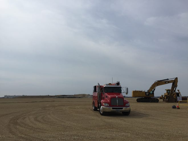 A truck is driven off Foxconn's planned building site in Mount Pleasant. The company has gotten conditional state approval of its plans for footings and foundations supporting a 977,000-square-foot flat-screen plant.