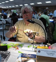 Terry Wilson of Bolivar, Mo., ties a fly Thursday morning at the 22nd annual Sowbug Roundup.