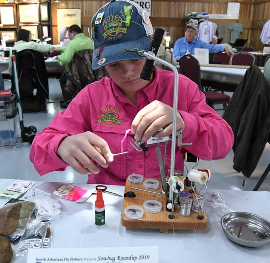 Jalen Riley of Mountain Home, works on creating a fly Thursday morning at the 22nd annual Sowbug Roundup.