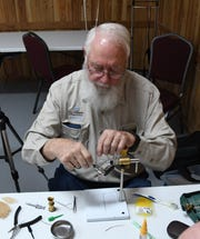 Ralph Rhoades of Parker, Colo., ties a fly Thursday morning at the 22nd annual Sowbug Roundup.
