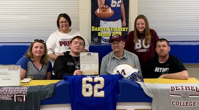 Mountain Home offensive lineman Dakota Tolbert signed Wednesday to play college football at Bethel College in Kansas. Shown with Tolbert are his mother, Melissa Tolbert, his father, Donny Tolbert, his grandparents, Pam and Buddy Welch, and his sister, McKenzie Tolbert.