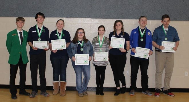 Honorees at the 4-H Awards Banquet include: (from left) Brent Clark 4-H State Officer and guest speaker; Chase Blum, first place, state record book; Caitlyn King, first place, foods and nutrition project; Kelsey Utter, first place, beef project; Kelsey Roach, first place, horse project; Quinn Hodges, first place, horse project; Hunter Blum, first place, citizenship project; and Tony Street, first place, wildlife project.