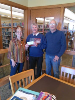Dana Johnson (left), president of the Palette Art League of Yellville, accepts a $500 donation fromJerry Preator and Tim McClandsborough of the Bull Shoals Art Club. Not picutred:Lilly Dana, past president of the Bull Shoals Art Club.