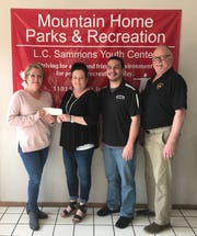 The Mountain Home Elks Lodge #1714 recently presented a $200 check to the Mountain Home Parks and Recreation department for the sponsoring of the Spring Carnival, slated for 11 a.m.-1 p.m., Saturday, April 13, at the L.C. Sammons Youth Center in Cooper Park. Pictured are: (from left) Susan Knoll, Elks Benevolence chairman; Kelly Lewis, MHP&R Recreation Manager; Enoch Pepin, MHP&R Program Coordinator; and Wayne Markham, Elks Lodge president.