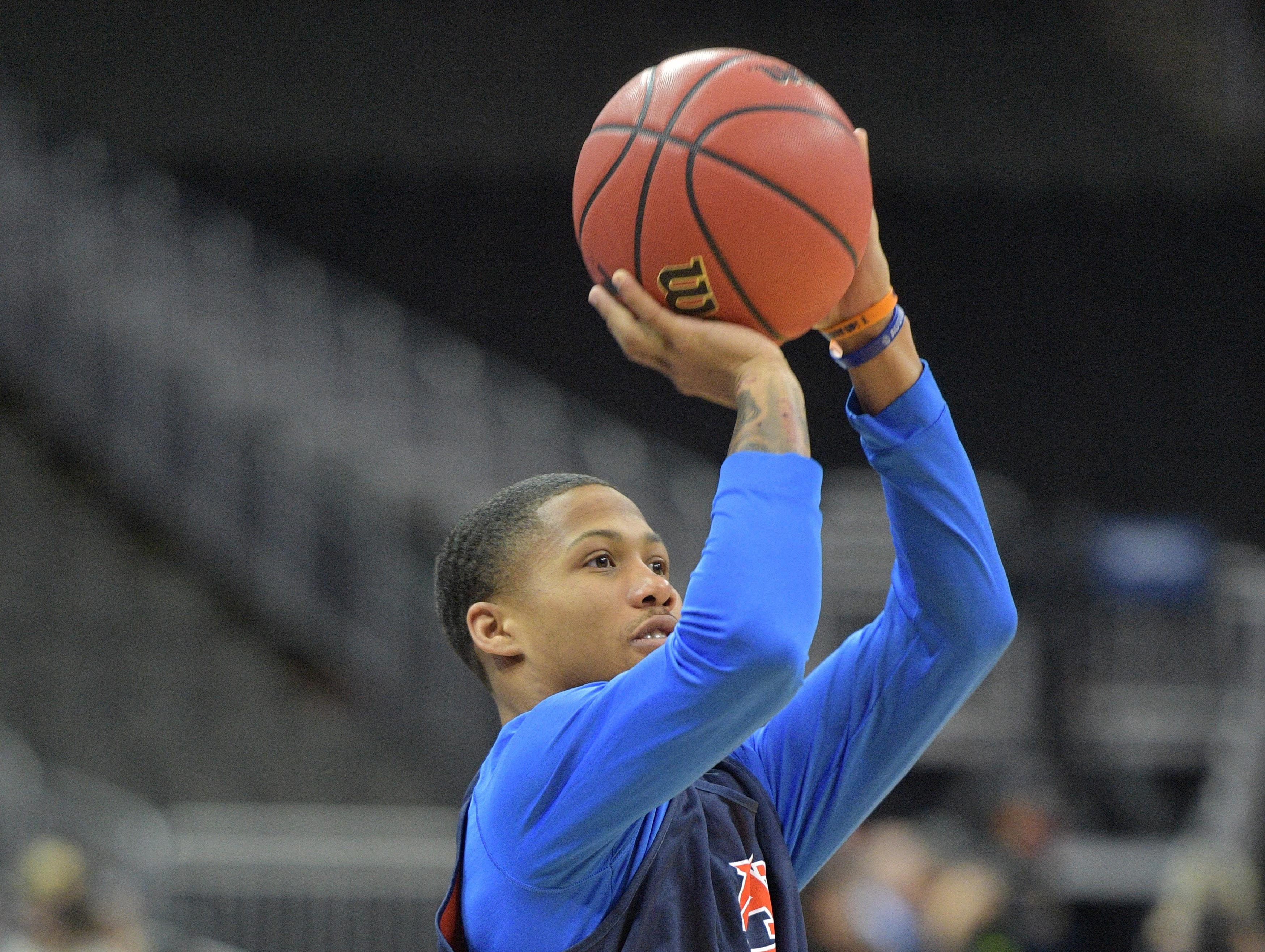 Mar 28, 2019; Kansas City, MO, United States; Auburn guard J'Von Mccormick (12) shoots during practice for the midwest regional of the 2019 NCAA Tournament at Sprint Center. Mandatory Credit: Denny Medley-USA TODAY Sports