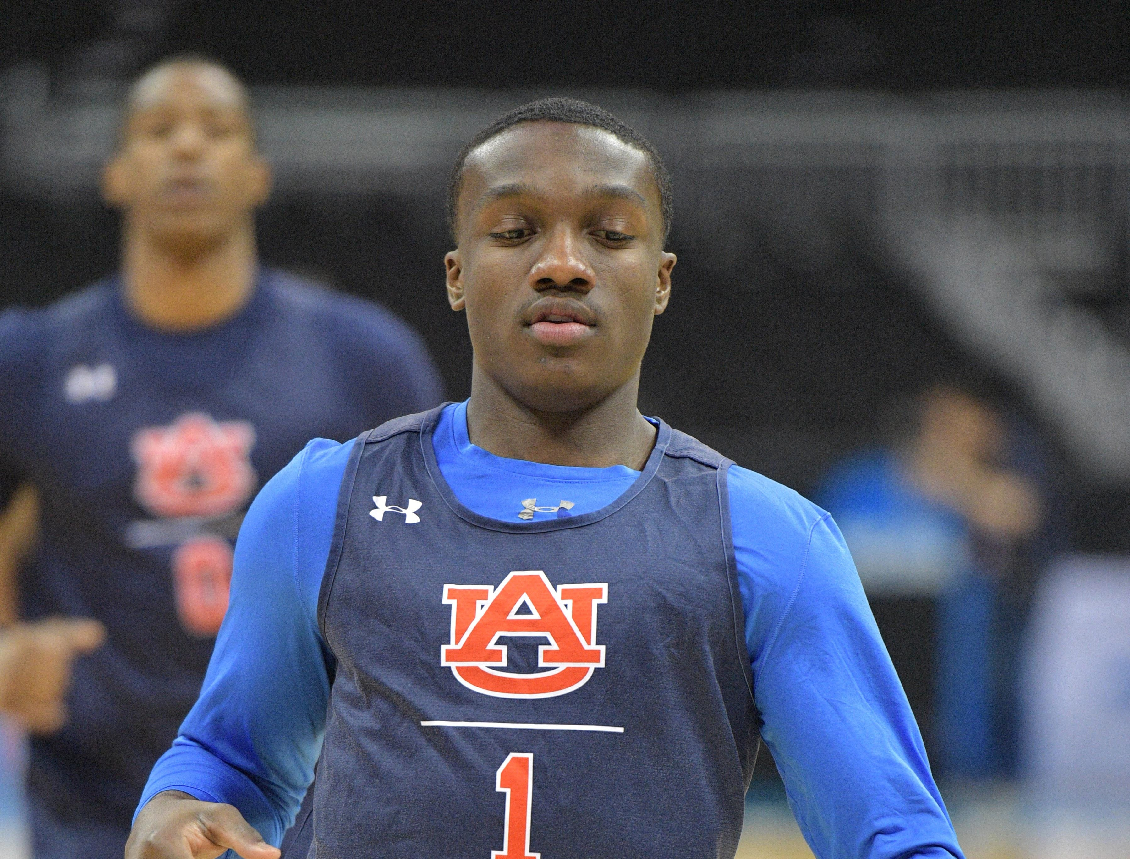 Mar 28, 2019; Kansas City, MO, United States; Auburn Tigers guard Jared Harper (1) runs drills during practice for the midwest regional of the 2019 NCAA Tournament at Sprint Center. Mandatory Credit: Denny Medley-USA TODAY Sports
