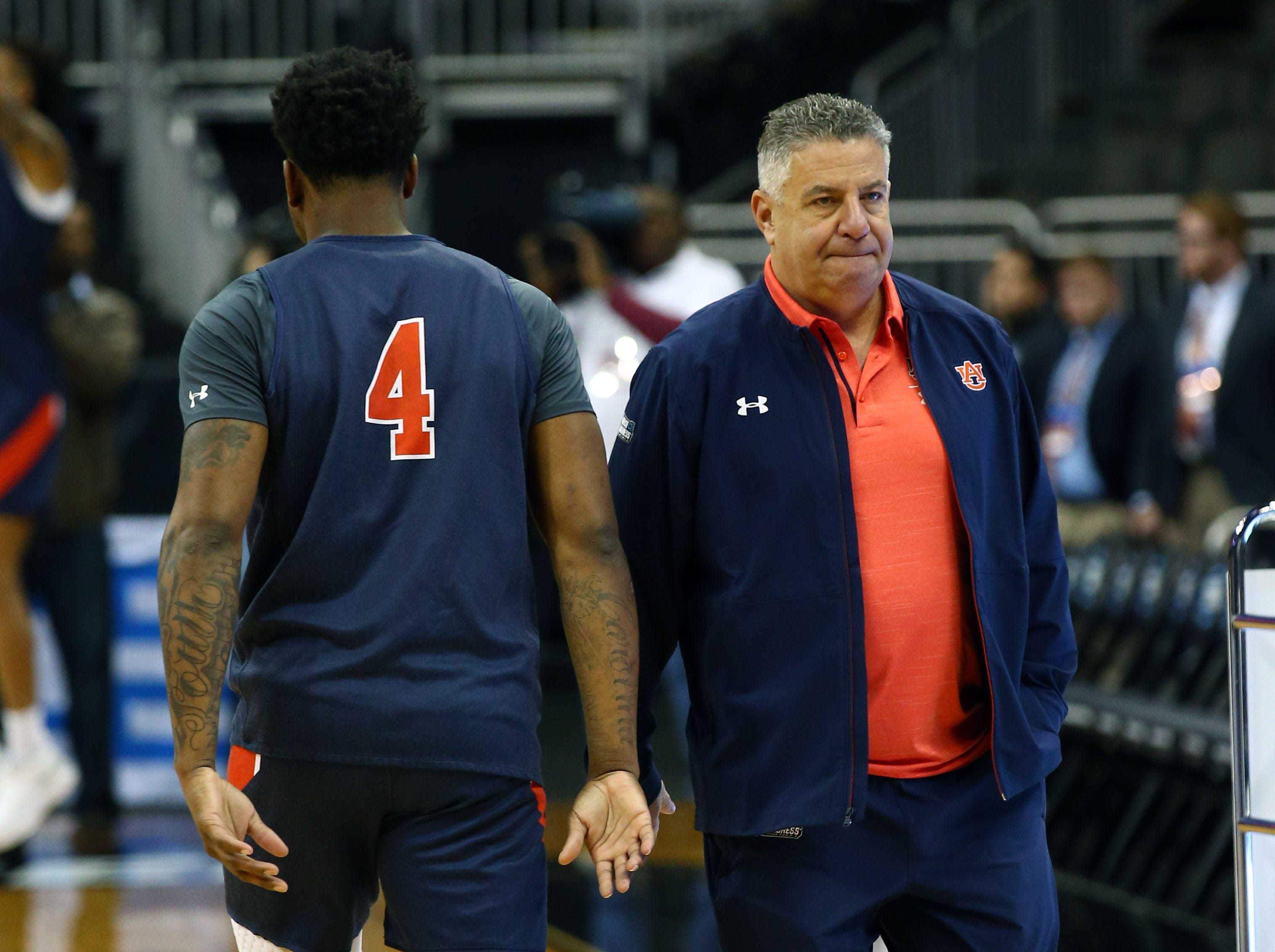 Mar 28, 2019; Kansas City, MO, United States;  Auburn Tigers head coach Bruce Pearl and guard Malik Dunbar (4) during practice for the midwest regional of the 2019 NCAA Tournament at Sprint Center. Mandatory Credit: Jay Biggerstaff-USA TODAY Sports