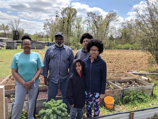 Geiger residents stand in the community garden on March 26, 2019.