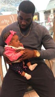 MTSU defensive end Tyshun Render with his daughter, Kenzlie Render