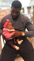 MTSU defensive end Tyshun Render with his daughter, Kenzlie Render