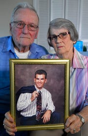 Brian Kelley's parents, Val Kelley and Betty Kelley, hold a portrait of their son. Brian Kelley was sentenced to life in prison for killing his baby daughter, but his wife, parents, many others in Wilson County have argued his mental illness merits a reduced sentence.