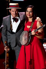 Ketch Secor and Rhiannon Giddens perform during the Country Music: A Concert Celebrating the film by Ken Burns concert at the Ryman Auditorium in Nashville, Tenn., on March 27.