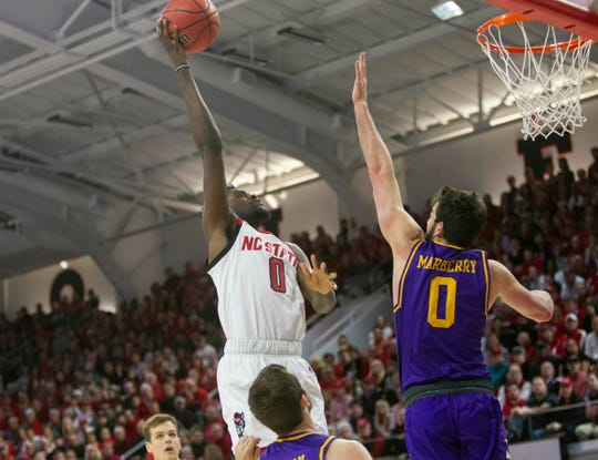 N.C. State's DJ Funderburk (0) shoots over Lipscomb's Rob Marberry (0) during the first half Wednesday.