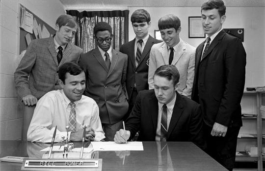 Trevecca College basketball coach Bill Boner, sitting left, smiles as he signs the school's first players to scholarships at the school April 19, 1969. Signing a grant is Gary Bedwell of Greenbrier High, while waiting their turn are Bill Griggs, standing left, and Nelson Ridley of Stratford High, Butch Baker of Joelton High, Mickey Johnson of Bethesda High and 1968 Hendersonville High guard Timmy Kemp.